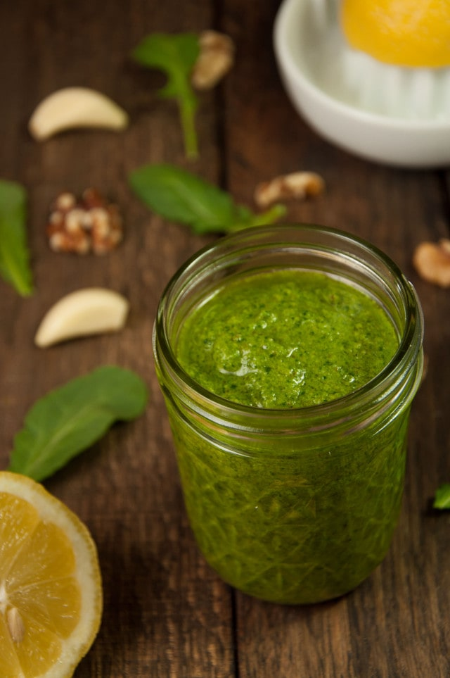 Easy arugula walnut pesto is the perfect sauce for pasta, gnocchi, sandwiches or anything else you can think of, and it only takes 10 minutes to make!