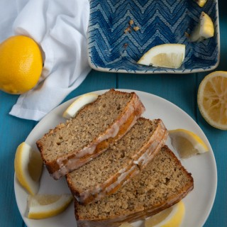 Delicious, light lemon poppy seed bread made with 100% whole wheat flour, agave, coconut oil, and topped with a zesty lemon glaze.