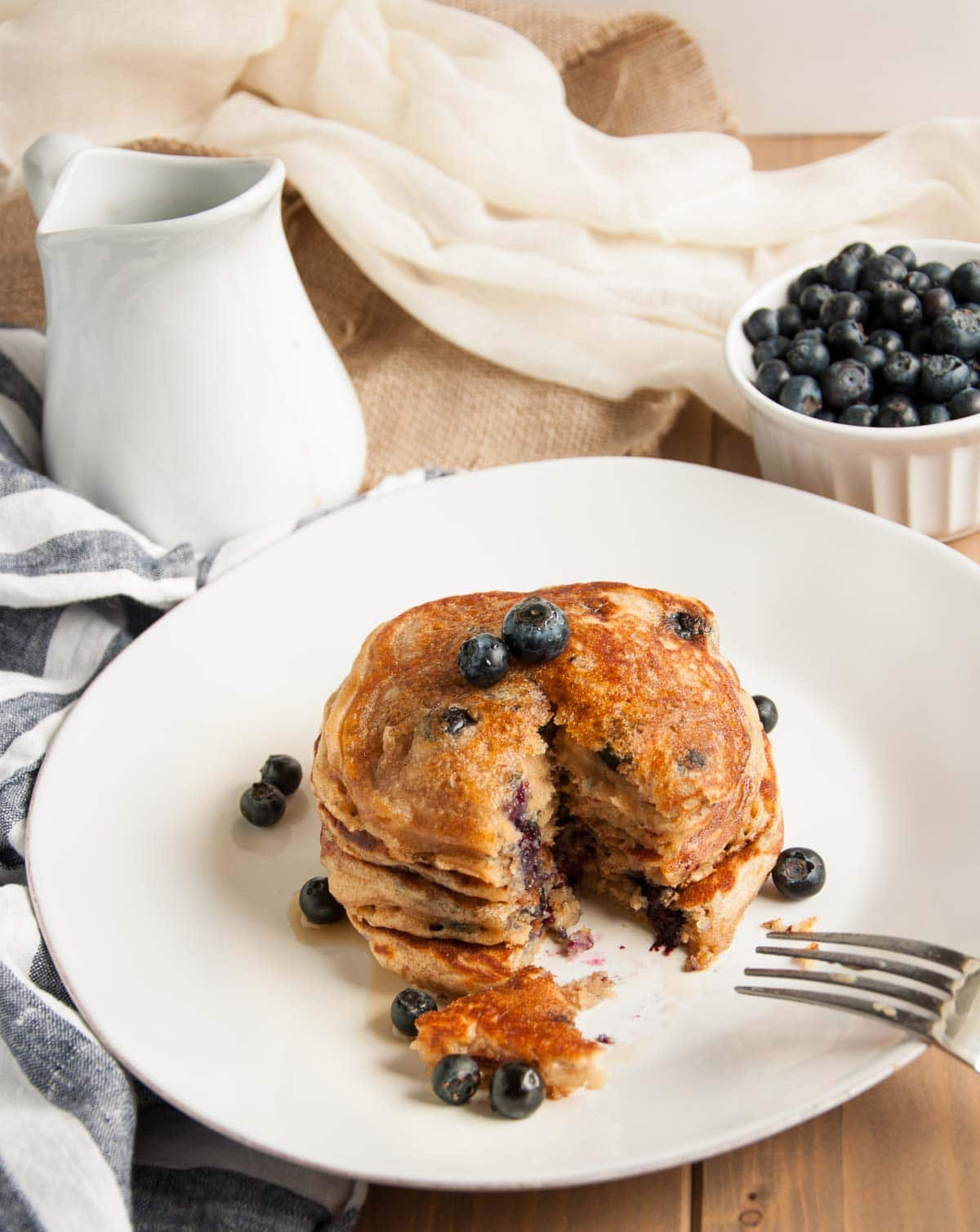 These thick, rich, delicious yogurt pancakes are a breakfast winner both in taste and nutrition, made with whole wheat flour, Greek yogurt, and blueberries.