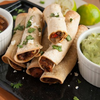 These baked black bean taquitos are both vegetarian, packed with veggies, and way lighter than the store bought kind without sacrificing any flavor.