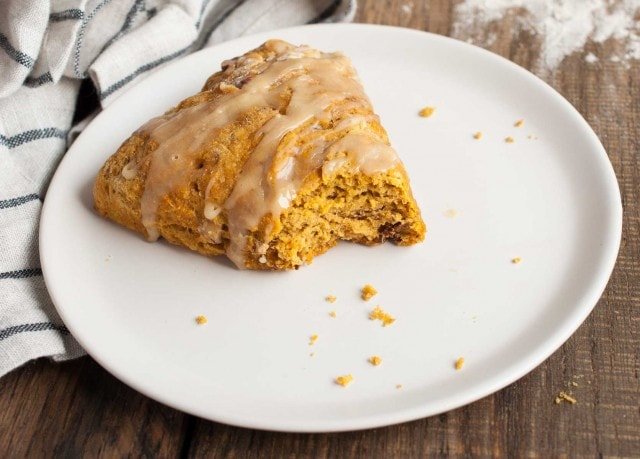These easy pumpkin scones are both healthy and delicious! They're loaded with pumpkin, toasted pecans, and use whole wheat flour and less sugar. - Feasting Not Fasting