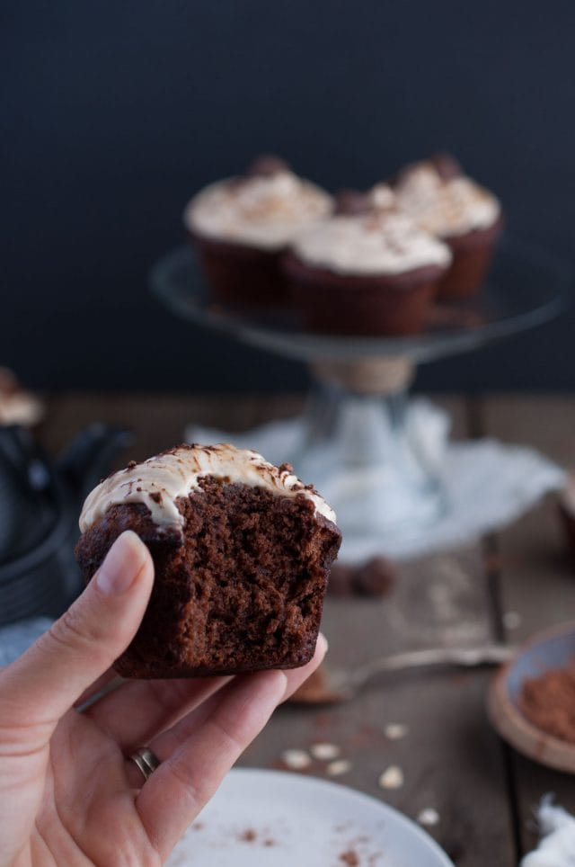 Chocolate peanut butter cupcakes that are outrageously decadent and rich but made healthy with oat flour, honey, and banana and coconut cream based frosting.