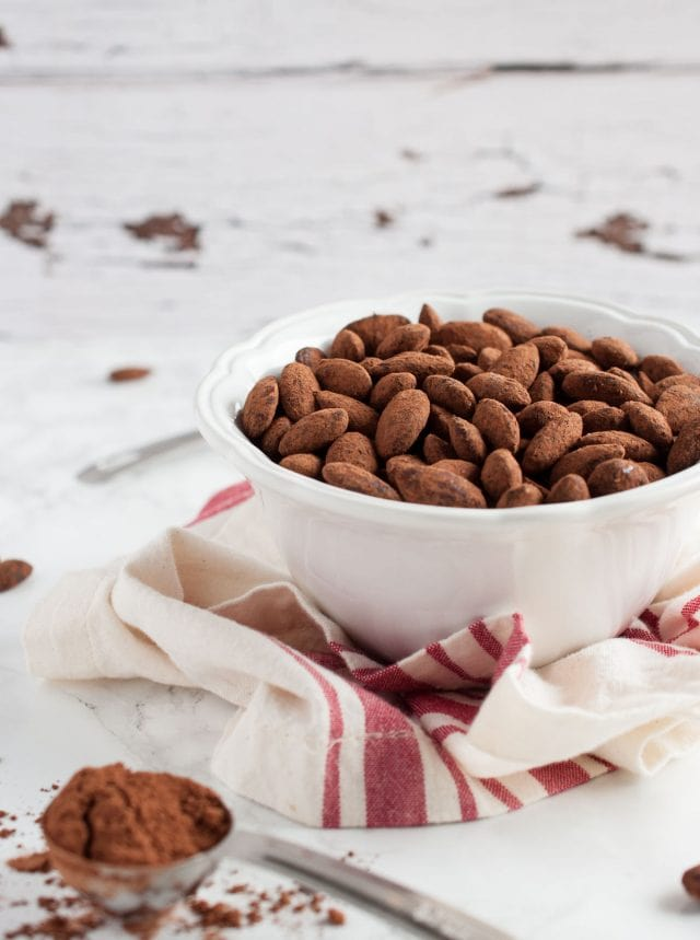 Cocoa roasted almonds are so easy to make! With simple ingredients like honey & cocoa powder, they're healthier than store bought, but equally delicious.