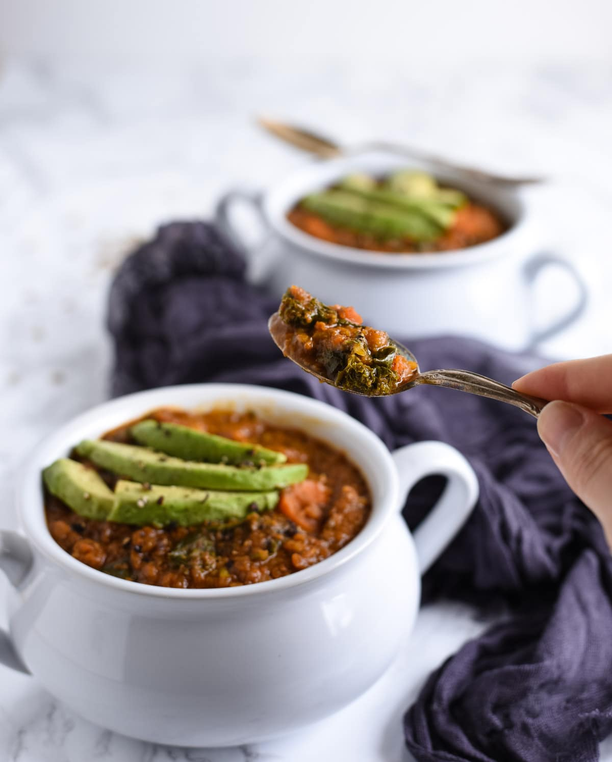 Curry lentil soup bite in spoon