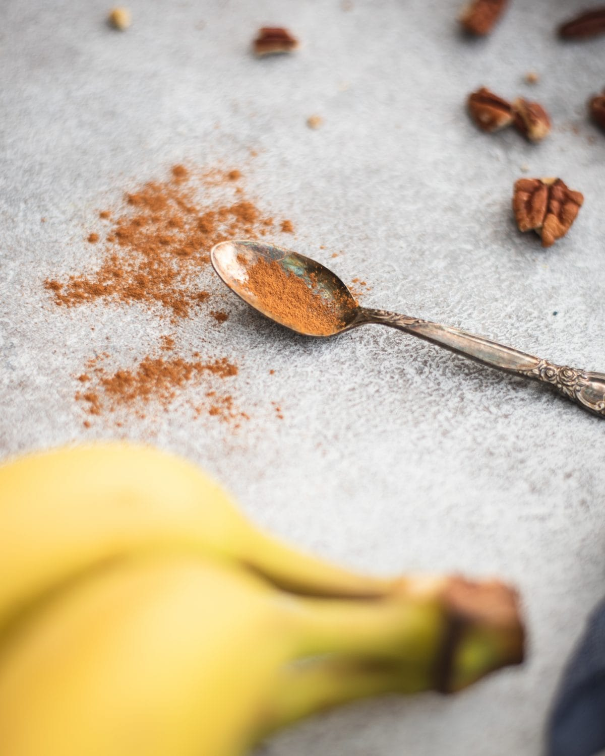 Spoon of cinnamon with bananas and pecans
