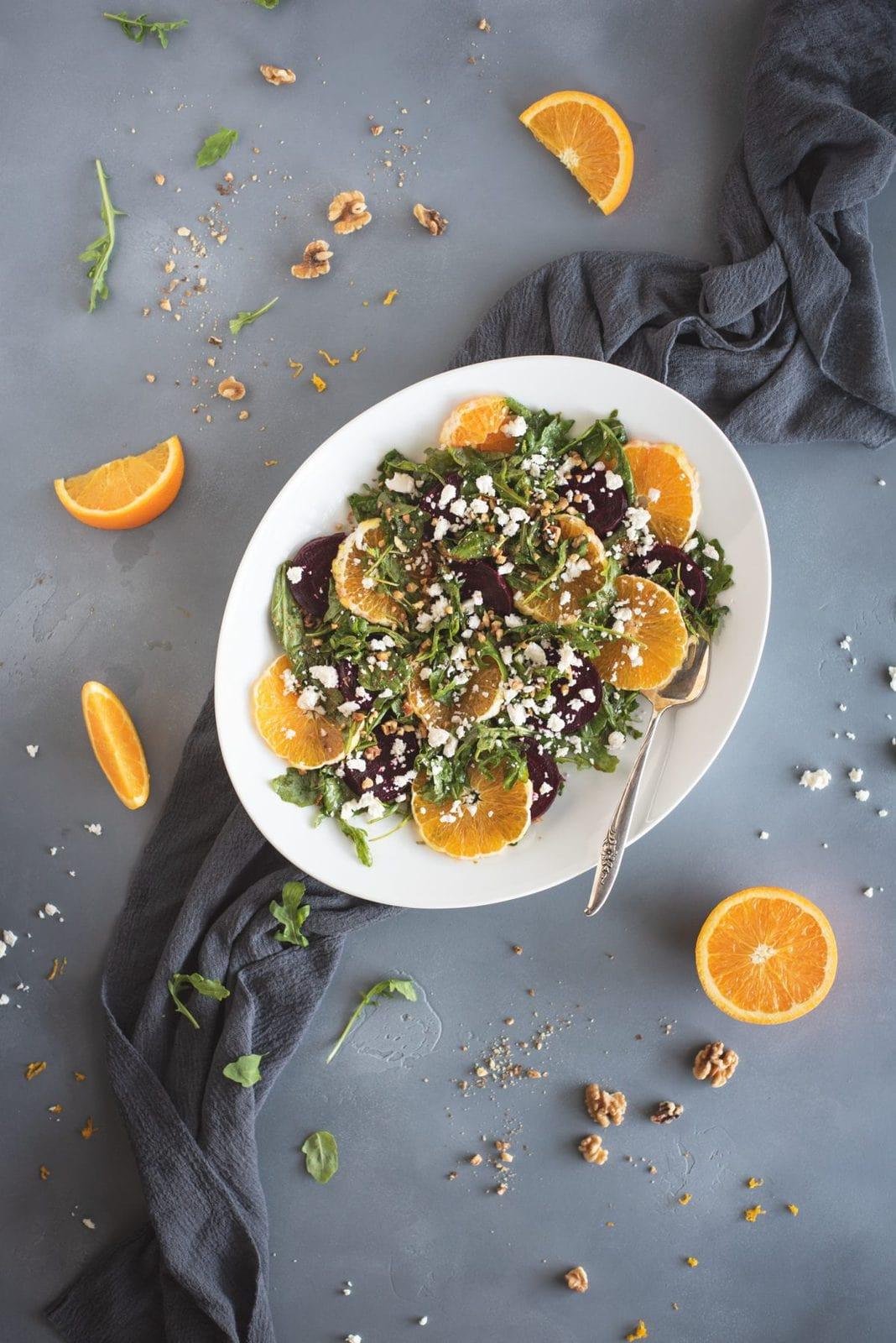 Photo of arugula salad with roasted beets and orange slices