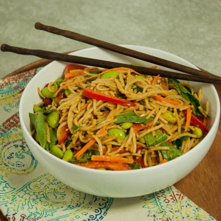 Nutrient rich soba noodles smothered in creamy, delicious peanut sauce and tossed with fresh vegetables and Thai basil for a tasty and healthy main dish.