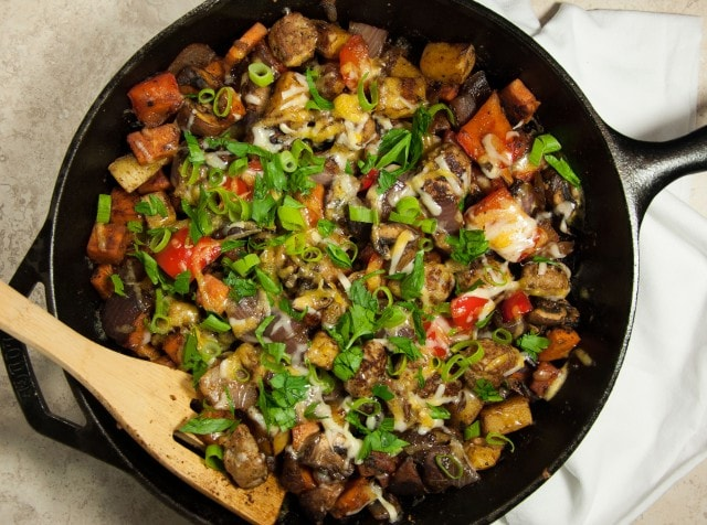 This satisfying ooey gooey cheesey potato skillet is the ultimate comfort food made lighter with sweet potato, red pepper, mushrooms, and fresh herbs.