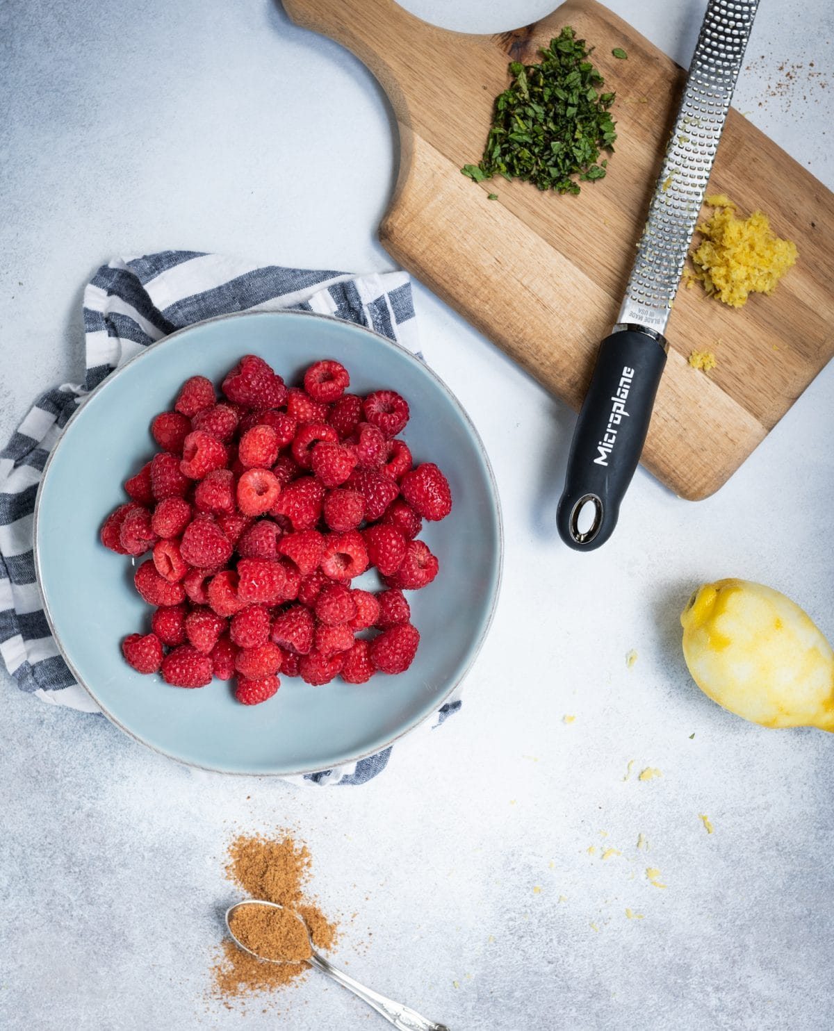 Overhead picture of Raspberries with lemon zest and mint ingredients