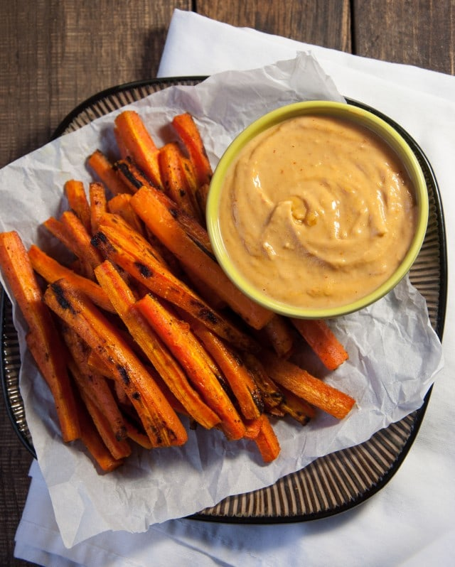 These curry roasted carrots are so tasty they're addicting! Luckily these tasty carrot fries are loaded with vitamins and guilt free so you can eat all you want.