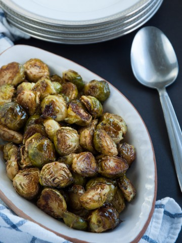 Roasted brussel sprouts are caramelized to perfection and then tossed in a tangy, savory browned butter sauce for ultimate yum factor.