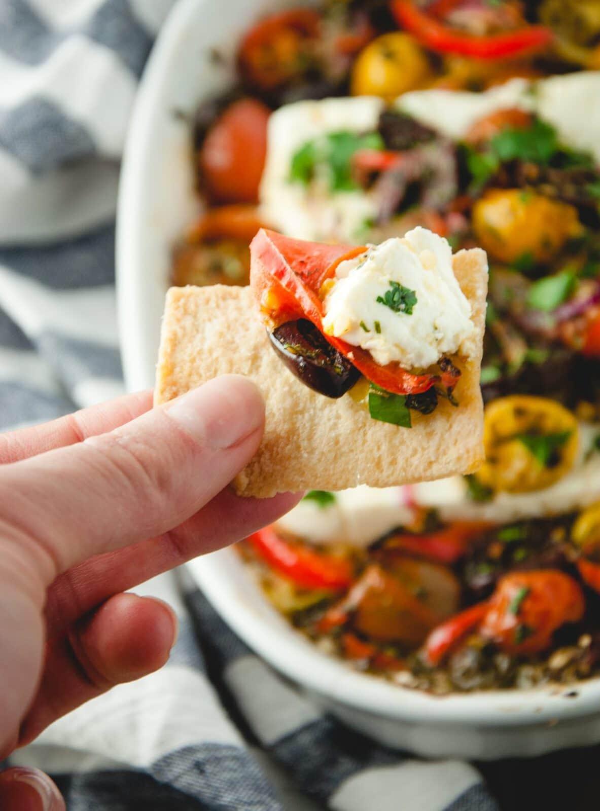 Mediterranean baked feta on a cracker