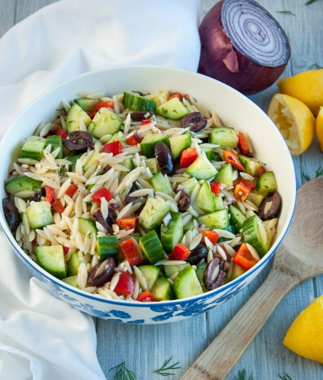 Delicious cucumber salad is loaded with orzo, red pepper, and kalamata olives tossed in a refreshing lemon dill dressing.