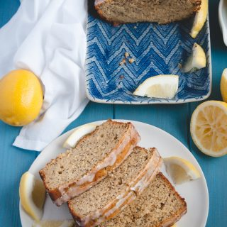 Loaf of Whole Wheat Lemon Poppy Seed Bread with slices on plate