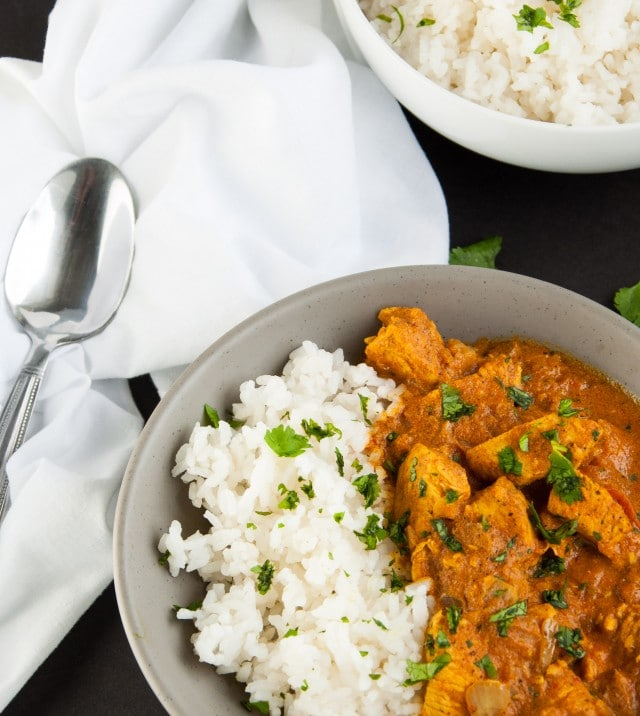 Let the crock-pot do the work with this exotic spice filled chicken Indian curry and come home to a delicious dinner simmering and ready to eat. Yum!