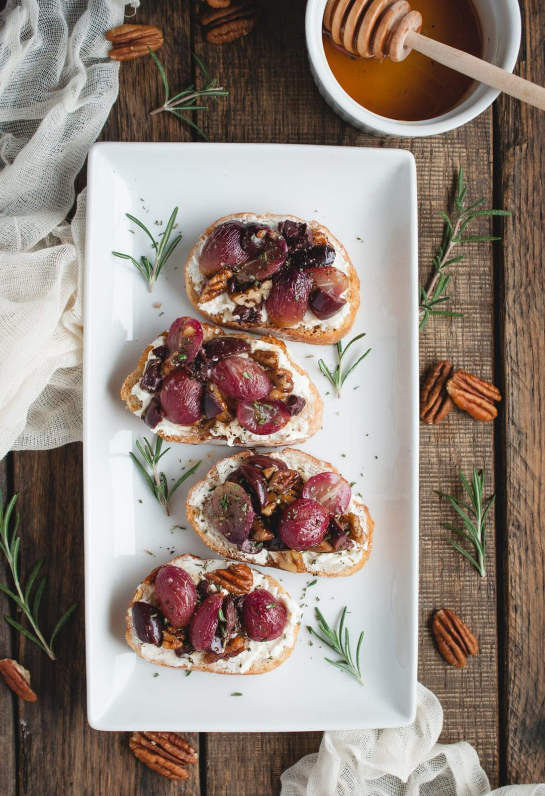 Overhead picture of Crostini with Roasted Grapes, Goat Cheese, and Pecans
