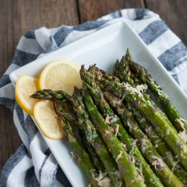 It will take longer for the oven to heat up than to prep this tasty lemon parmesan asparagus! Simple ingredients come together in this classic versatile side dish. - Feasting Not Fasting