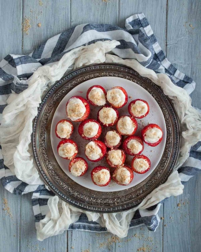 These tasty cheesecake stuffed strawberries are a healthier dessert that will actually satisfy your sweet tooth for under 100 calories per serving.