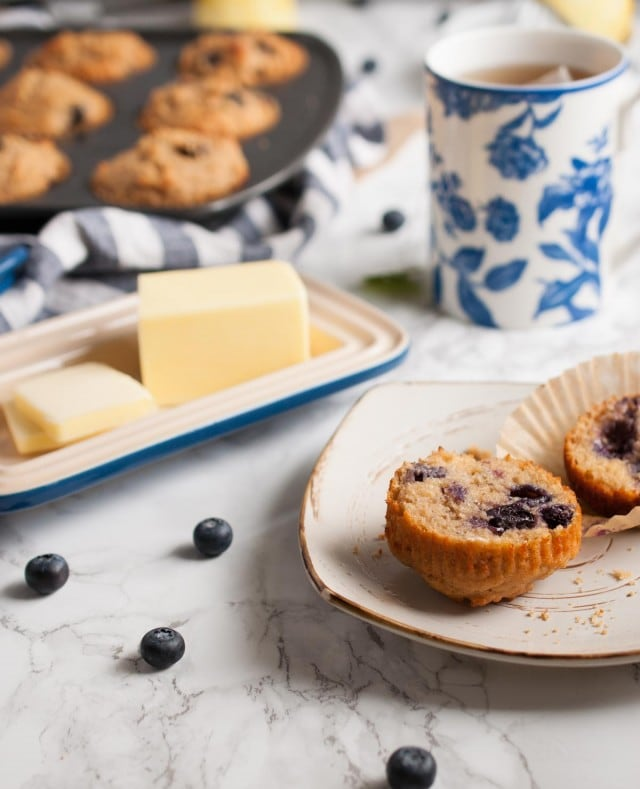 These whole wheat blueberry muffins are made with wholesome ingredients like honey, coconut oil, and Greek yogurt to your make breakfast more nutritious.