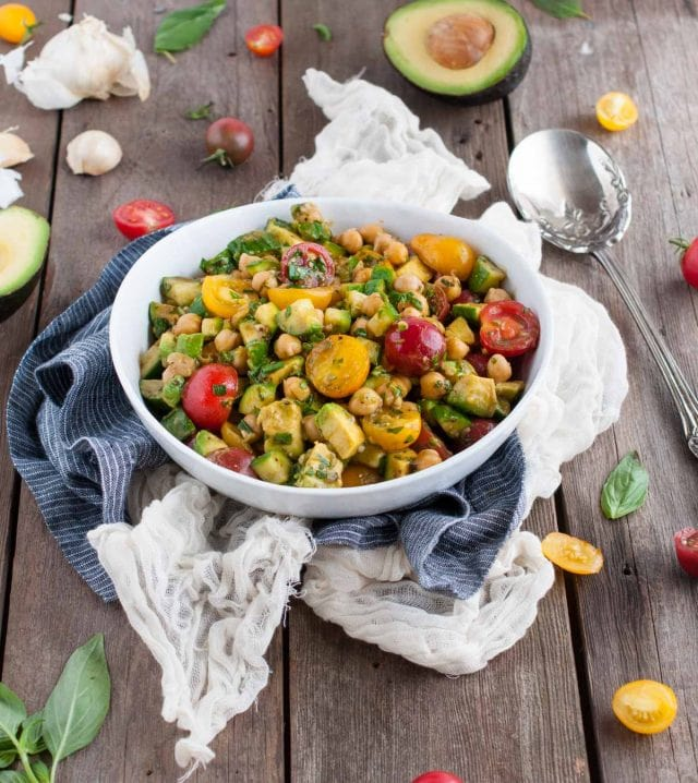 This chickpea salad so light and refreshing with fresh basil, balsamic vinegar, tomatoes, and avocado. Its naturally vegan but has so much flavor, you'd never know it!