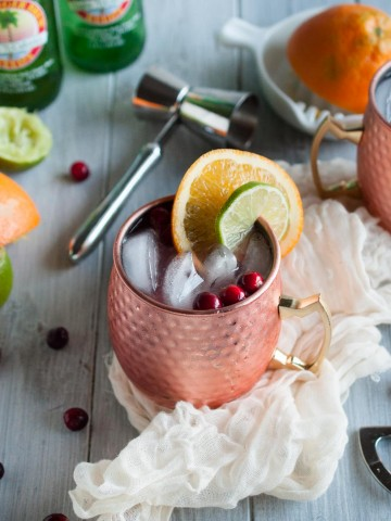 Cranberry Moscow mules made with zesty orange, zippy ginger beer, vodka, lime, and cranberry just might be the most refreshing drink on the planet. Try one today with this recipe!
