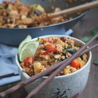 Picture of Thai fried brown rice bowl with chopsticks