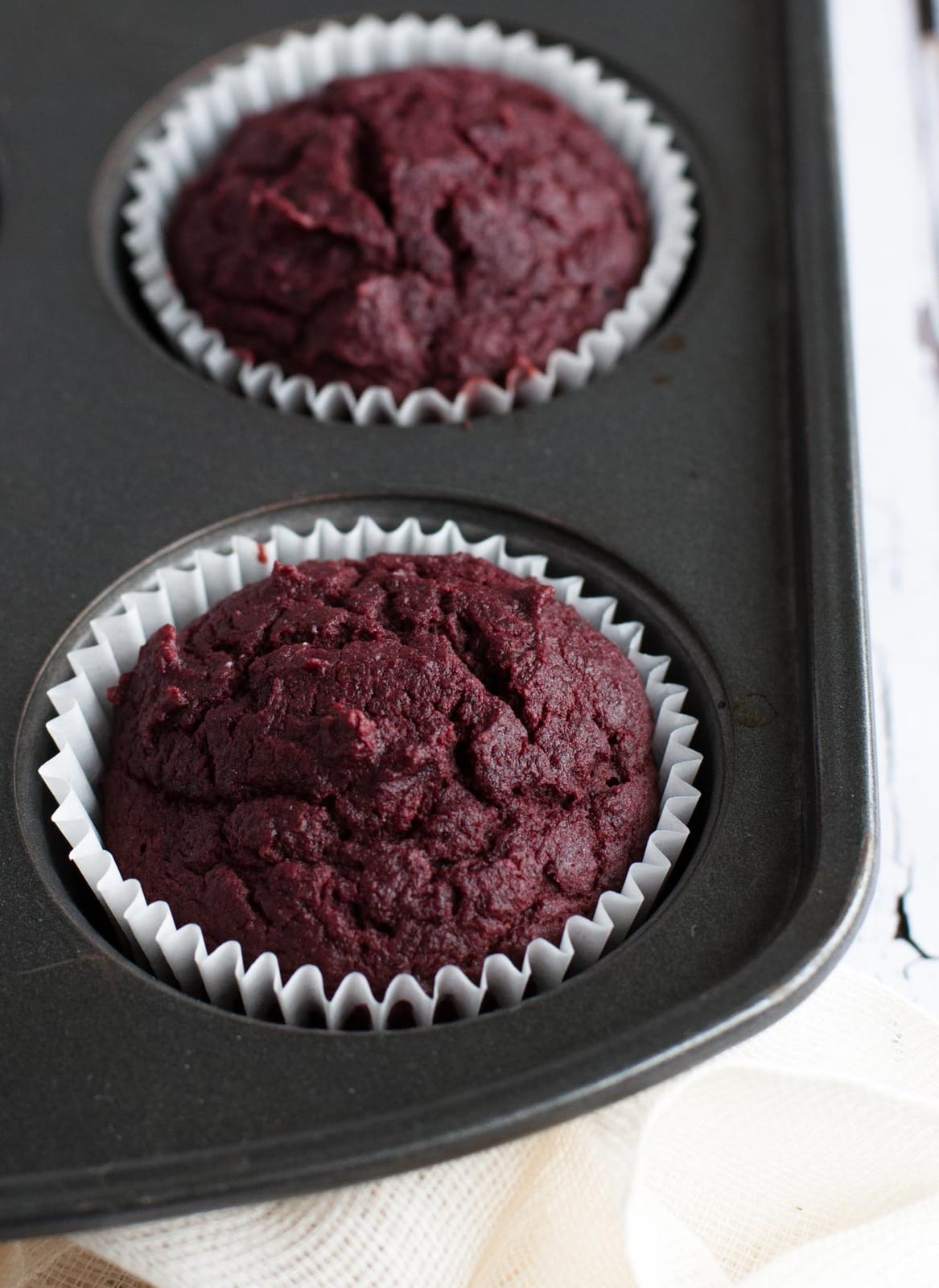 Healthy yet tasty beet red velvet cupcakes are made with whole wheat flour and no processed sugar. They're topped off with a decadent cream cheese frosting.