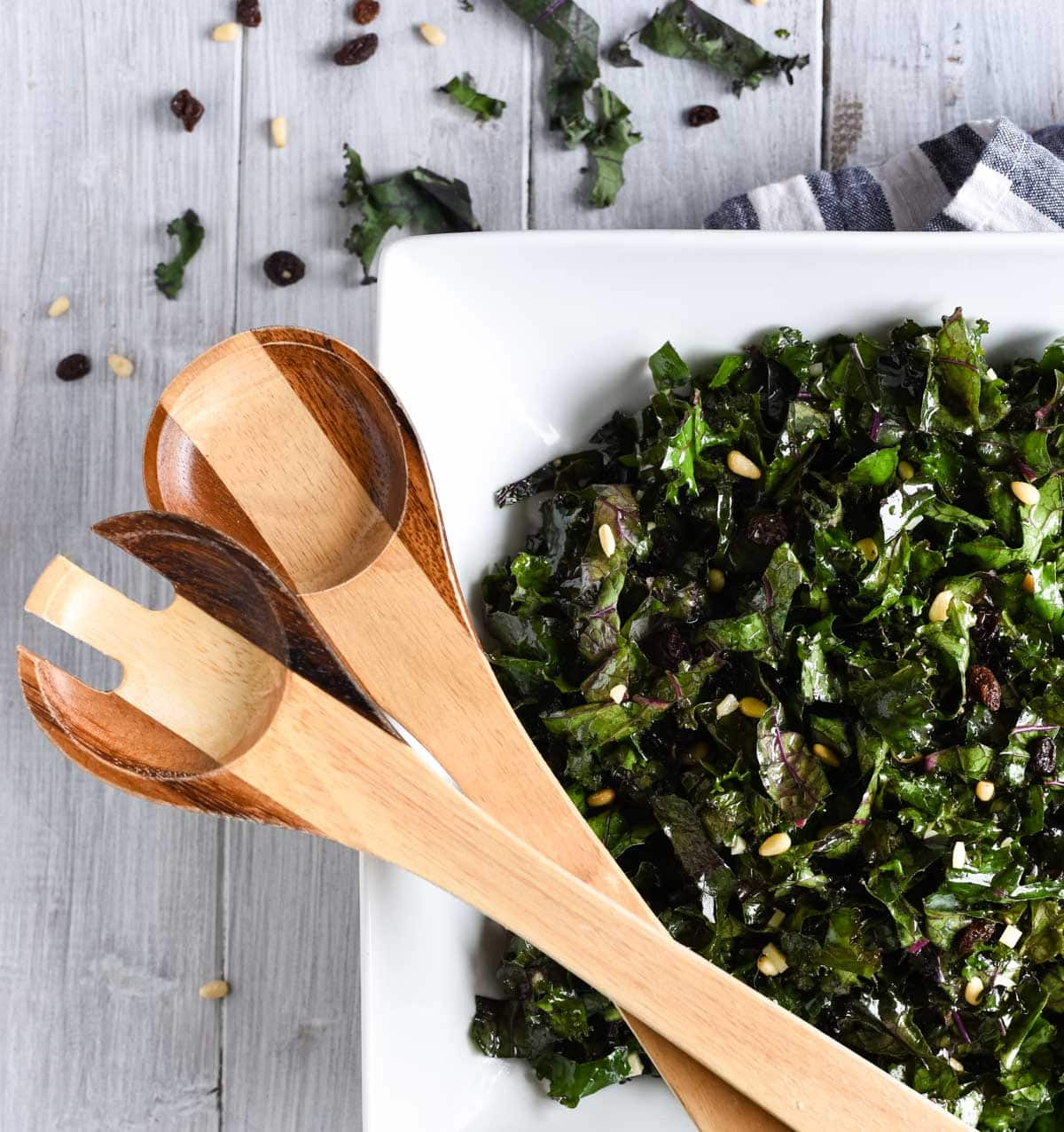 Overhead shot of kale salad with serving spoons