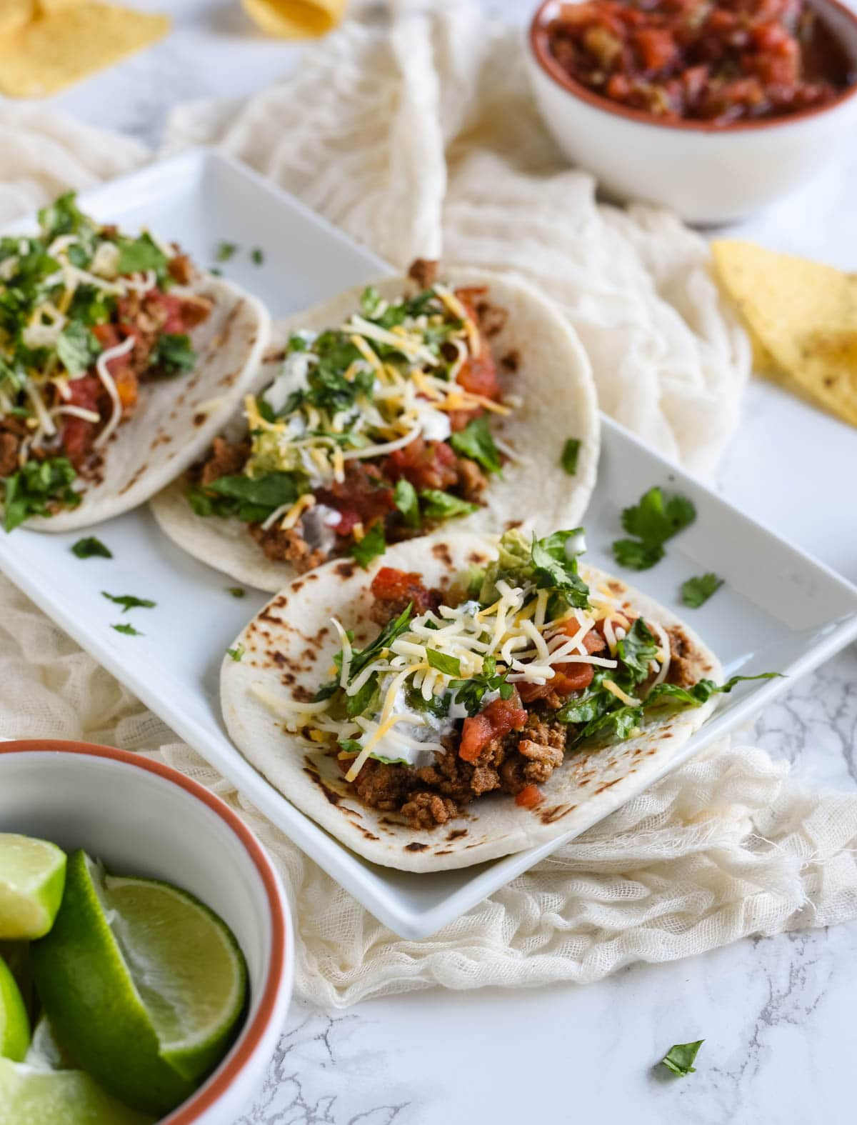 Healthy turkey tacos recipe that's loaded with peppers, spices and comes together in half hour or less! We eat this all the time - its simply the best!