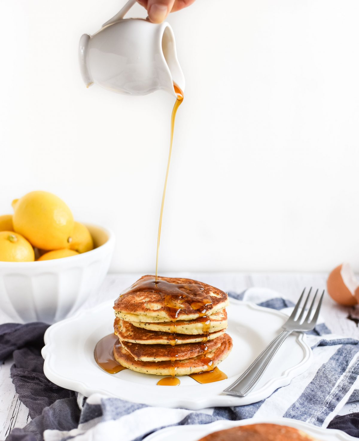 Lemon poppy seed pancakes with syrup drizzled on top picture