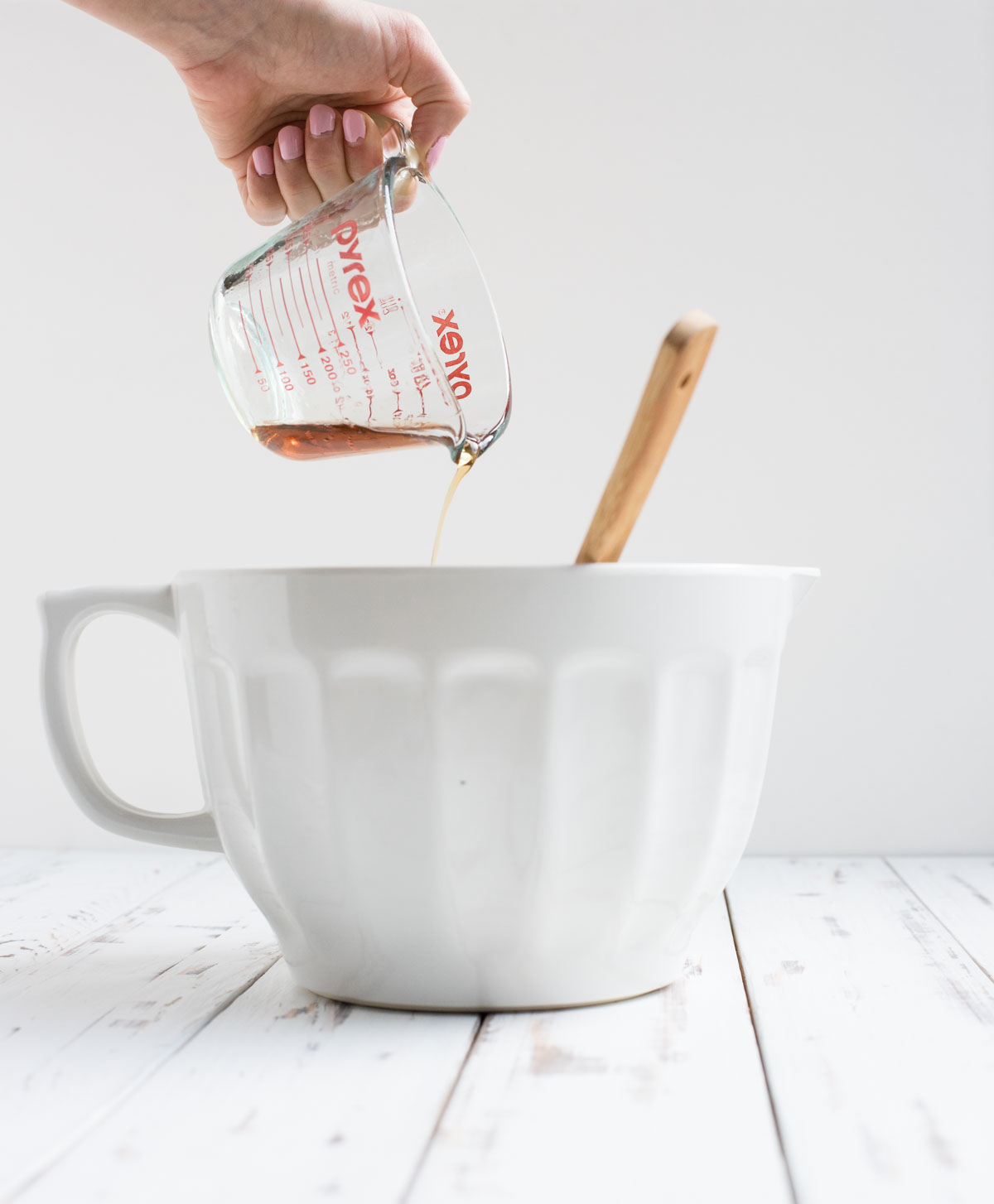maple syrup being pulled into a mixing bowl