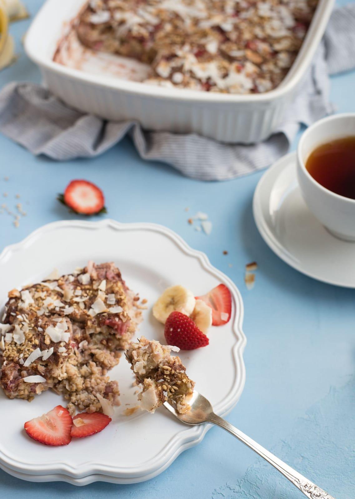 Strawberry banana steel cut oat bake breakfast plate with bite