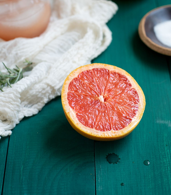 sliced grapefruit on green tabletop