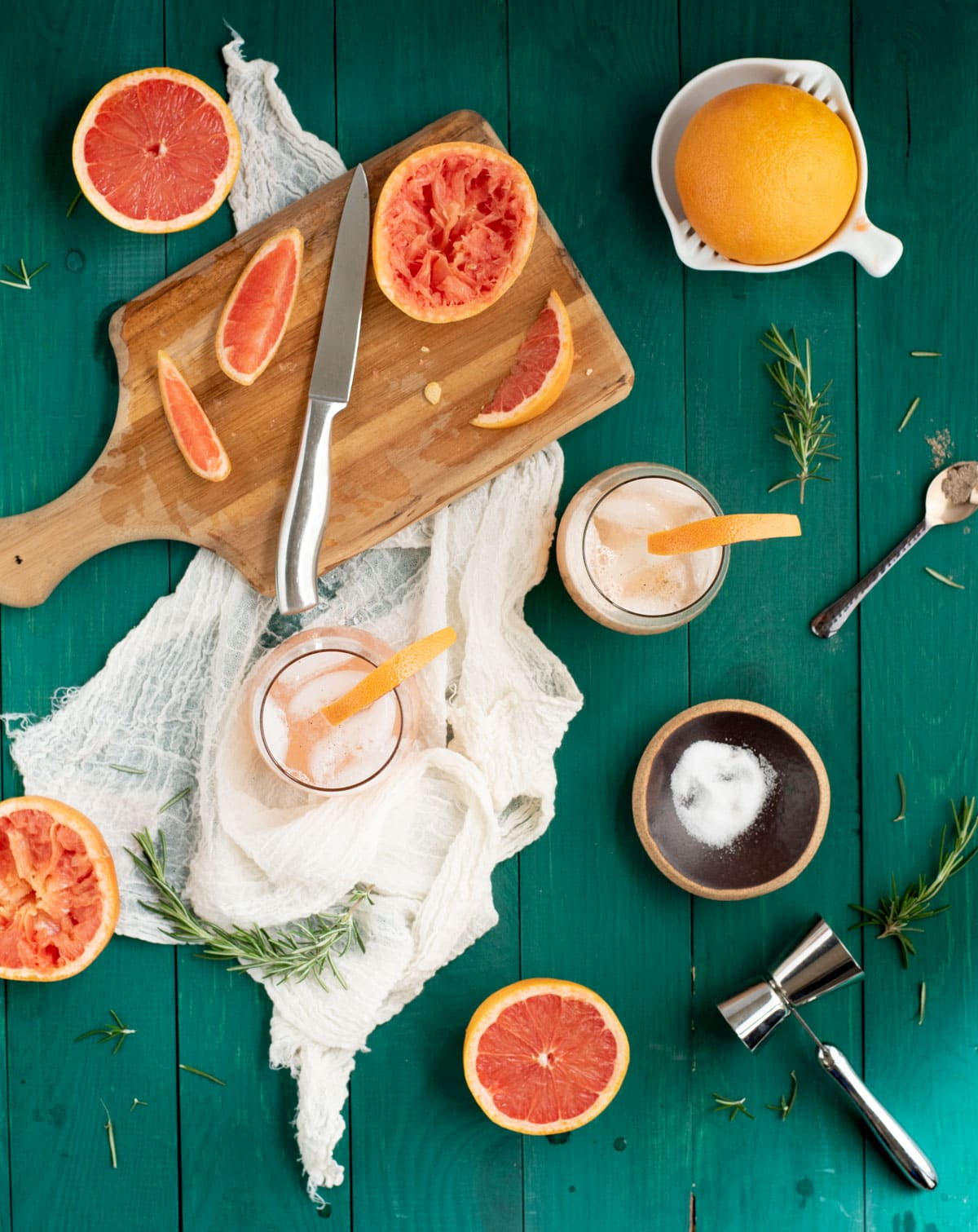 Rosemary grapefruit mocktails on a green tabletop from overhead