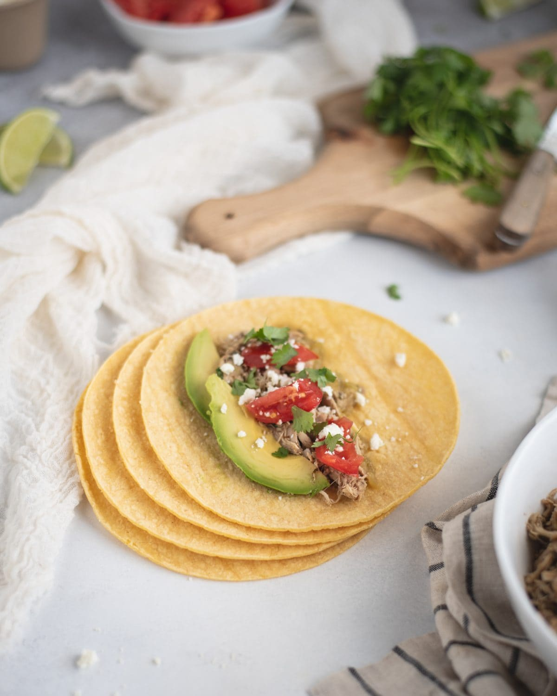 Slow Cooker Cilantro Lime Chicken Taco picture on corn tortilla