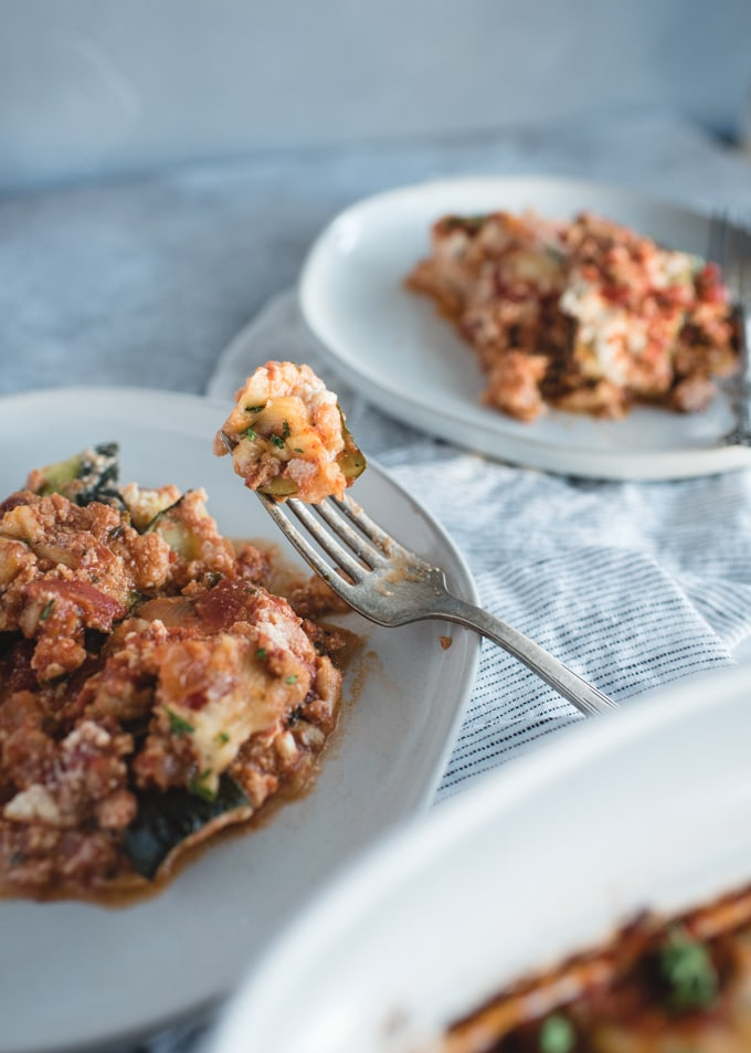 bite on a fork of zucchini lasagna