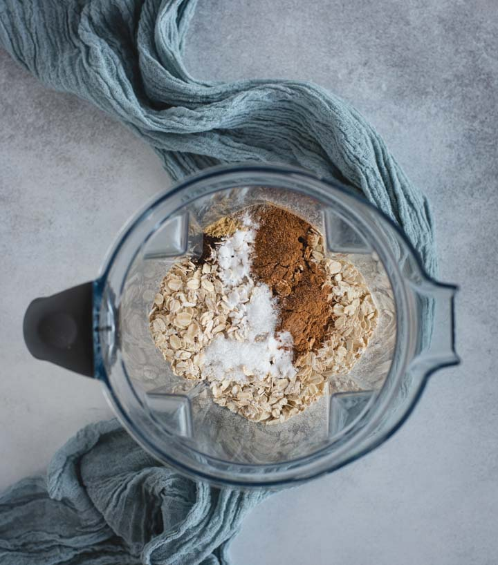 oats and spices in a vitamix blender
