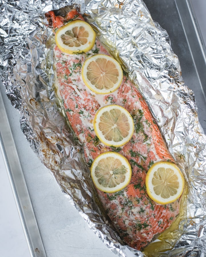 oven baked salmon with lemon and dill in tin foil