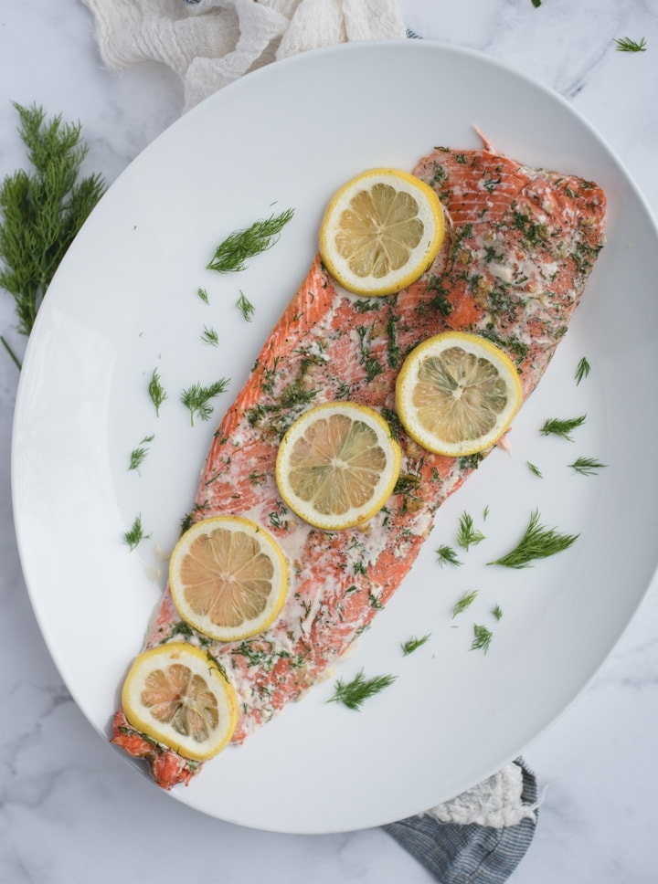 Overhead picture of oven baked salmon with lemon and dill