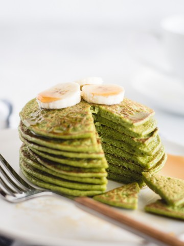 close up picture of stack of green spinach pancakes