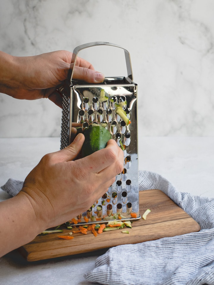 hand grating zucchini