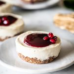 close up picture of a pomegranate mini cheesecake