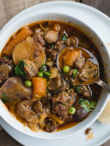 overhead picture of irish beef stew in a white bowl