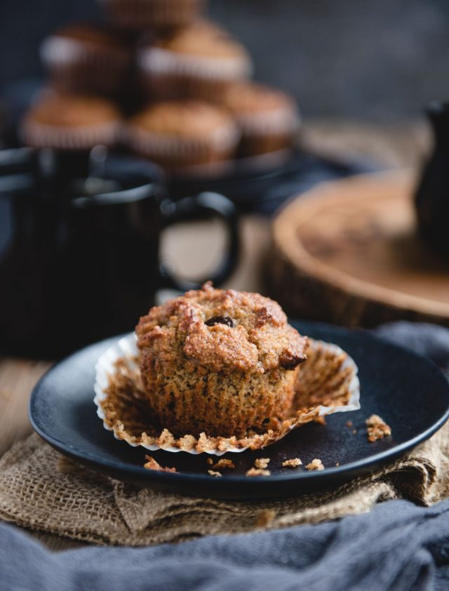 Close up picture of an almond flour banana muffin on a black plate