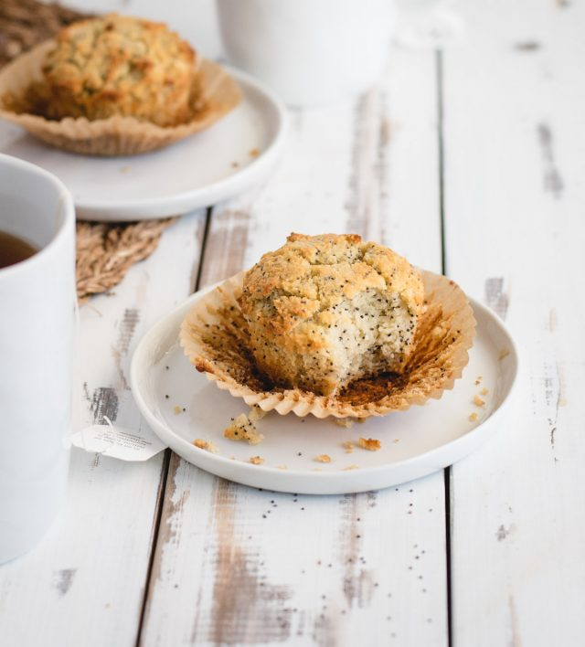 almond poppy seed muffin on a white plate