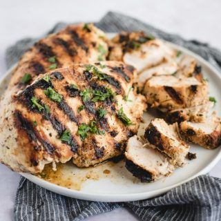 marinated greek chicken on a white plate