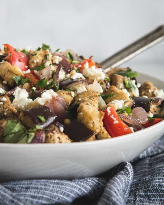close up picture of Mediterranean eggplant salad tossed with feta and herbs