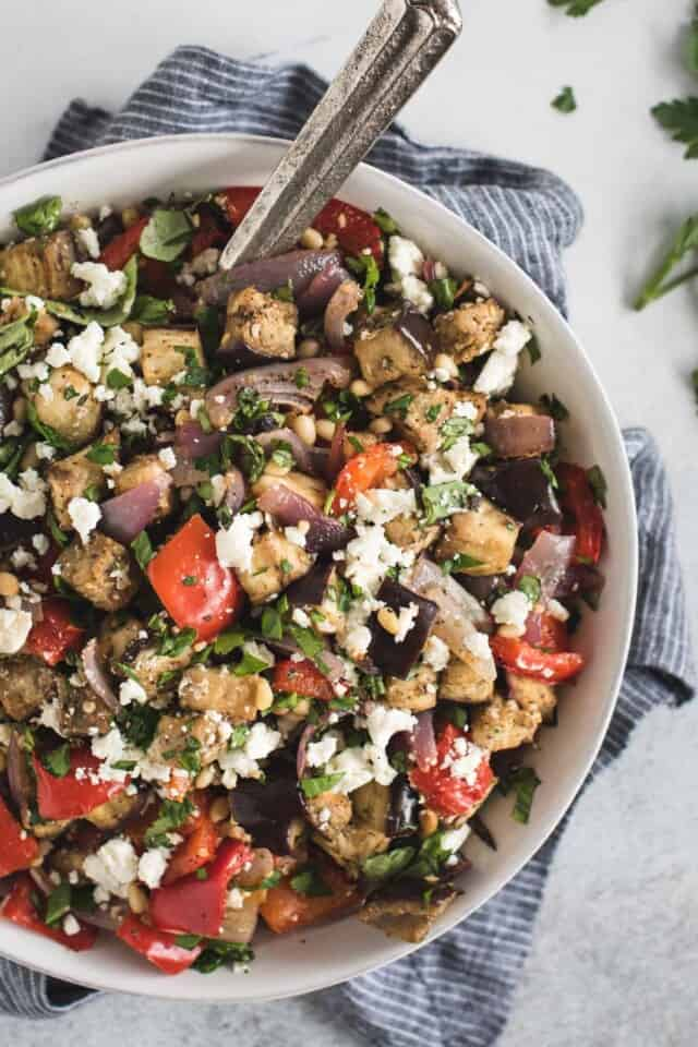 overhead picture of Mediterranean eggplant salad in a white bowl